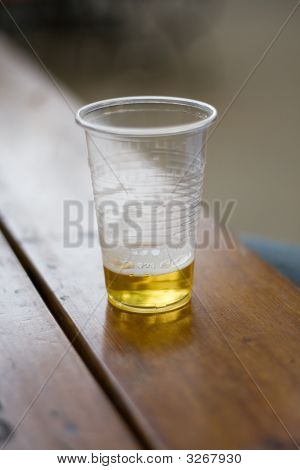 Cold Beer In The Plastic Glass