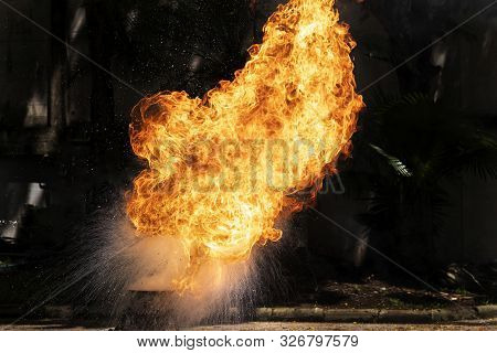 Flames Caused By The Explosion Of The Oil. Demonstration Of Water On Oil Fire.