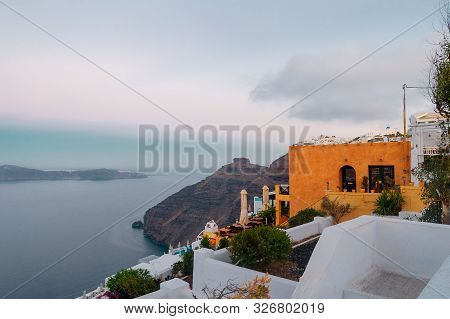 Fascinating View Of The Aegean Sea And Beautiful Santorini Town. Rock Mountains In The Water And His