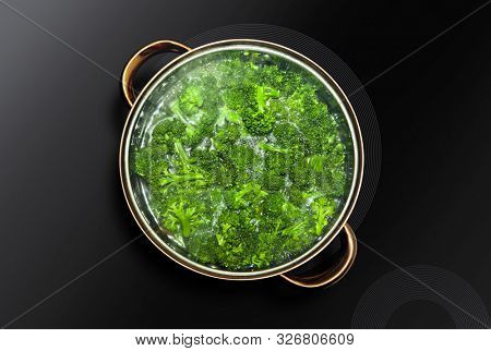 Green broccoli cooked in a saucepan