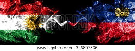 Kurdistan Vs Liechtenstein, Liechtensteins Smoke Flags Placed Side By Side. Thick Colored Silky Smok