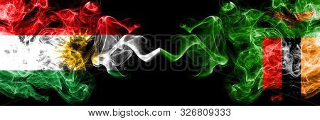 Kurdistan Vs Zambia, Zambian Smoke Flags Placed Side By Side. Thick Colored Silky Smoke Flags Of Kur