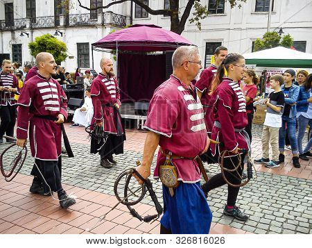 Timisoara, Romania - October 10, 2019: Warriors With Whips In National Traditional Costumes March Al