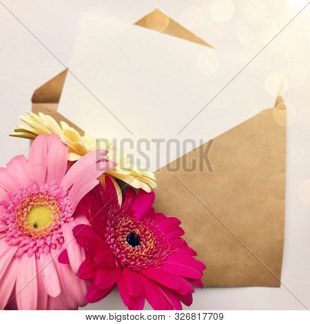 Greeting Card Concept With Envelope And Gerbera Flower. Blank Paper Postcard, Vintage Envelope And G