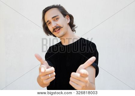 Confident Cocky Guy Choosing You. Handsome Young Man With Curly Moustache Standing Over White Backgr