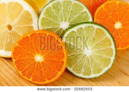 Sliced Citrus Fruit, Limes, Lemons And Oranges