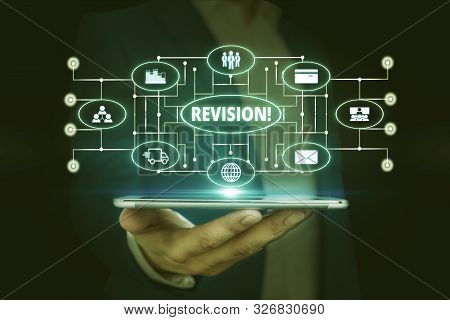 Word writing text Revision. Business concept for action of revising over someone like auditing or accounting Male human wear formal work suit presenting presentation using smart device. poster