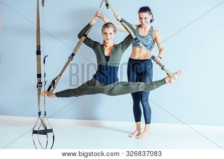 Active Candid Female Trainer Instructor In Sportswear And Client Workout With Strap Suspension Train