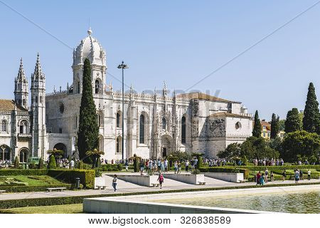 Lisbon, Portugal - August, 2019. Tourists Walking In Front Of The Jeronimos Monastery Or Hieronymite