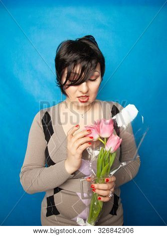 Disgruntled Woman With A Bouquet Of Flowers Emotionally Shows Hatred And Disgust For Cut Flowers. Th