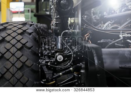 Close-up Of New Suspension System And Shock Absorber Of Car With Wheel. Automotive Part Of Atv Off R