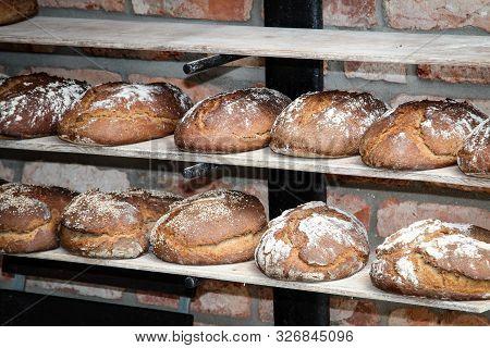 Bread, Bread Loaves Lie Side By Side On A Board