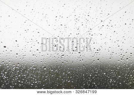 Close-up On Window Stained With Autumn Rain. Abstract Texture With Falling Raindrops. Condensation O