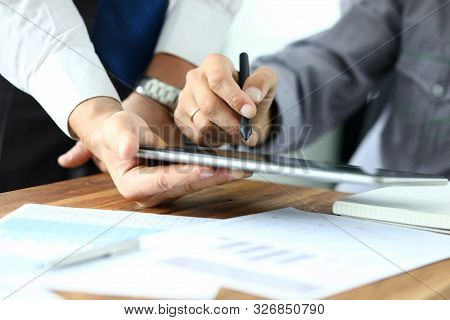 Focus On Workers Hands Holding Tablet. Manager Giving For Signature E-documents. Director Signing Im