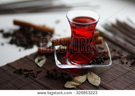 Ruby Carcade Tea With Cinnamon Stick, Cloves, Badyan And Bay Leaves