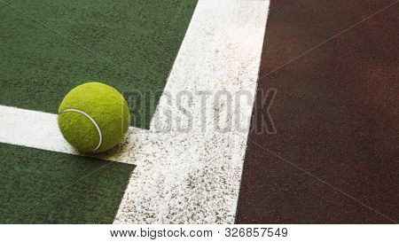 Yellow Tennis Ball Hitting The Sidelines On An Green And Orange Artificial Tennis Court, Sport Backg
