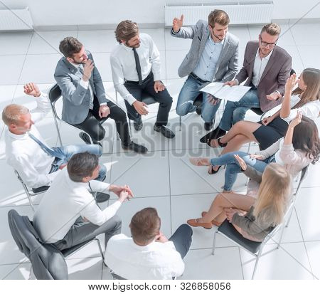 young employees ask questions during business training
