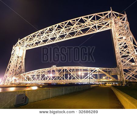 The Aerial Lift Bridge is a major landmark in Duluth, Minnesota. The span is a vertical lift bridge, which is rather uncommon. The bridge was added to the National Register of Historic Places on May 22, 1973. poster