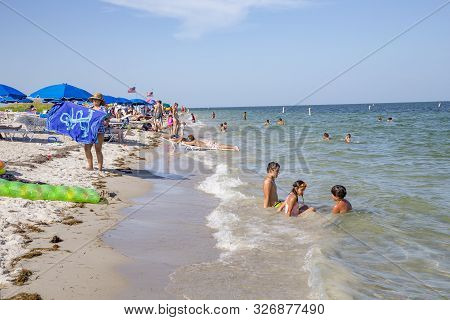 Miami, Usa - Aug 22, 2014: People Relax At The Crandon Park Beach In Miami, Usa. The Park Is More Th