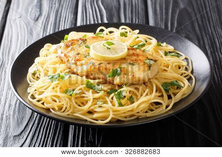 Roasted Breaded Chicken Francaise With A Side Dish Of Spaghetti Close-up On A Plate. Horizontal