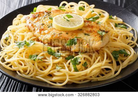 Traditional Chicken Francaise With Spaghetti With Lemon Sauce Close-up On A Plate. Horizontal