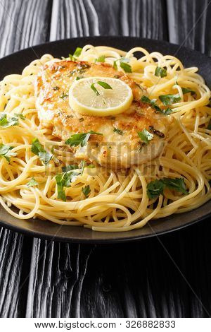 Italian-american Cuisine Chicken Francaise Served With Spaghetti With Lemon Sauce Close-up On A Plat