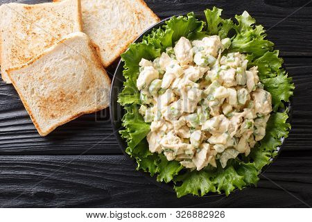Organic Chicken Salad With Celery, Eggs Seasoned With Sauce Closeup On A Plate. Horizontal Top View