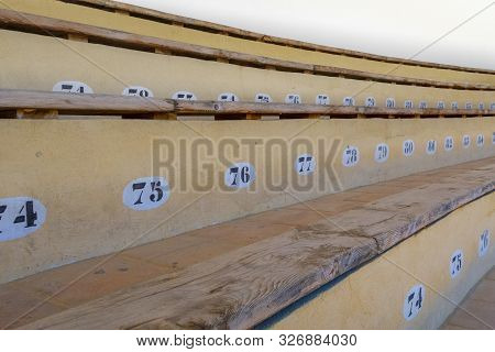 Ronda, Spain - May 17, 2018:  Seat Numbers For The Spectator Of The Bullring Fight In Ronda.  The Bu