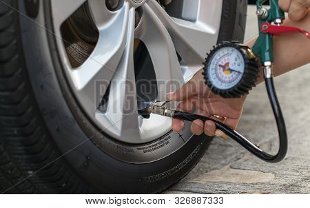 Inflating The Tires Car And Checking Air Pressure.