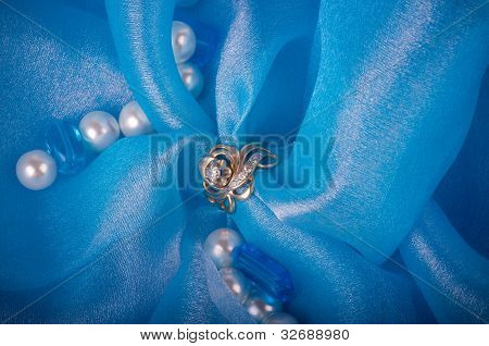 Gold jewelry rings on a blue background