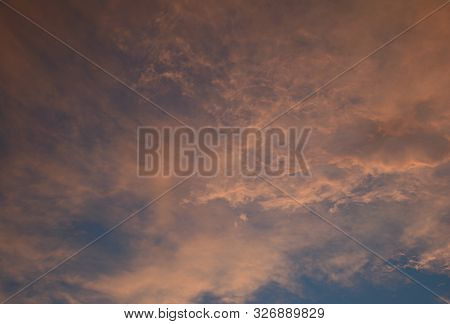 Colorful Vista On Pink Tinged Cumulus Cloud Formations And Blue Sky At Twilight Time.