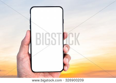 Hand Holding Mobile Smartphone Empty Touch Screen On Beautiful Sunset Sky Background.blank Free Word