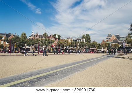 Amsterdam, The Netherlands, October 11, 2018: Walking  Squre Crowded With People In Front Of Rijksmu