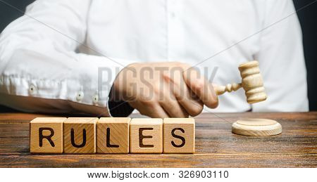 A man knocks a hammer publishes new rules and laws. Setting clear rule and restrictions. Leadership and discipline. Authoritarianism, tight control framework. Norms and laws in society, state poster