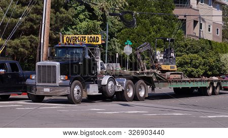 A Truck With A Special Semi-trailer For Transporting Oversized Loads. Excavator Transport.