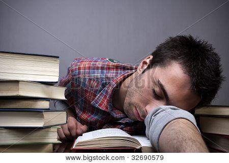 Young Man Sleeping On Books