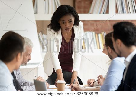 Serious Millennial Black Businesswoman Head Company Briefing In Office