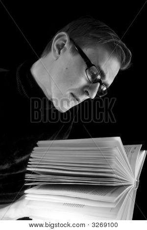 Man With Glasses And  Book
