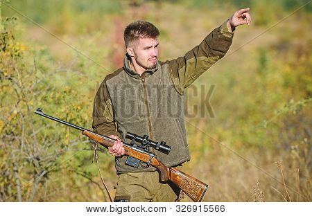 Man Brutal Unshaved Gamekeeper Nature Background. Hunting Permit. Hunter Hold Rifle. Hunting Is Brut