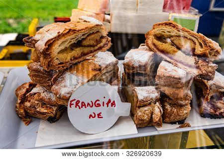Freshly Baked Pastries Are Seen Close Up On A Display Stand During An Outdoor Market For Local Baker