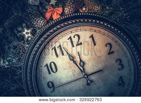 Old Clock Shows Midnight. New Years Still Life.