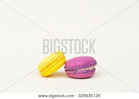 Two fresh macaroon confection over beige background poster