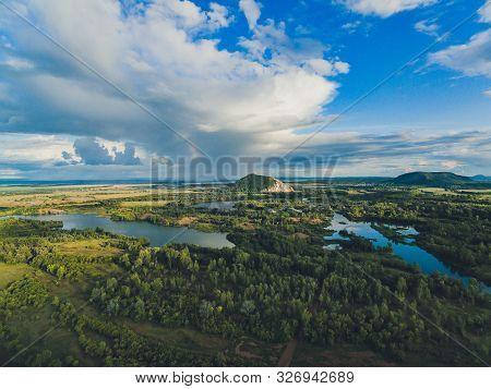 Oat Field And Village At The Foot Of Shihan Yuraktau. Republic Of Bashkortostan. Russia.
