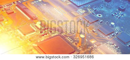 Closeup On Electronic Motherboard Card In Hardware Repair Shop. Blurred Panoramic Image With Details