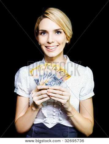 Business Woman Holding A Cash Bonanza