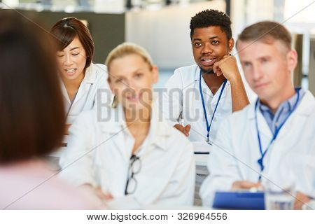 Group of doctors at a medical training or training hear a presentation