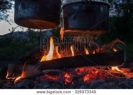 Black Pots At Bonfire, Cooking At Campfire In The Forest.