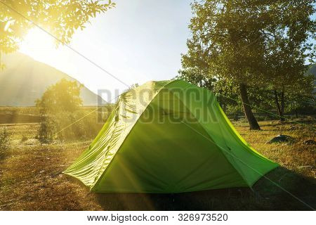 The Green Tent Dries Under The Morning Sun. Morning After A Thunderstorm In The Hike.