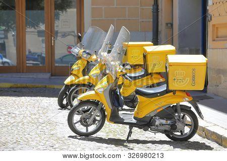 Segovia Spain - May 29, 2019: Spanish Post Office Delivery Motorbike Parked In Segovia Spain