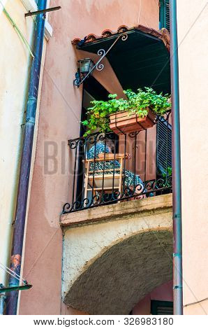 Monterosso Al Mare, Italy - September 02, 2019: Old Local Woman Is Sitting On A Balcony In Old Town